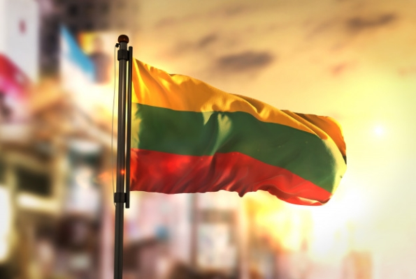 0001_lithuania-flag-against-city-blurred-background-at-sunrise-backlight_1379-1570_1530164489-44243e0e2c293bba62c004111575f624.jpg